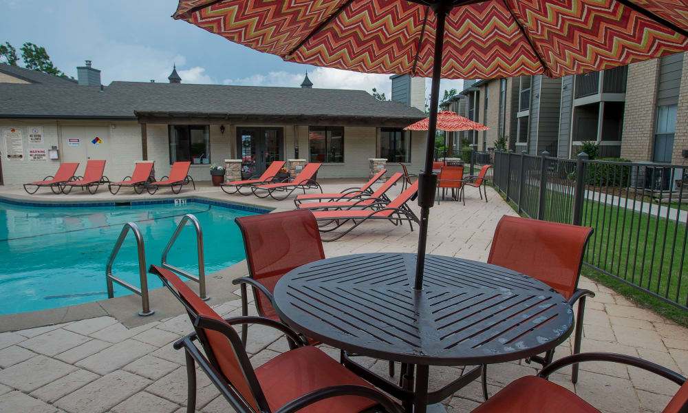 Seating next to the pool at Cimarron Pointe Apartments in Oklahoma City, Oklahoma