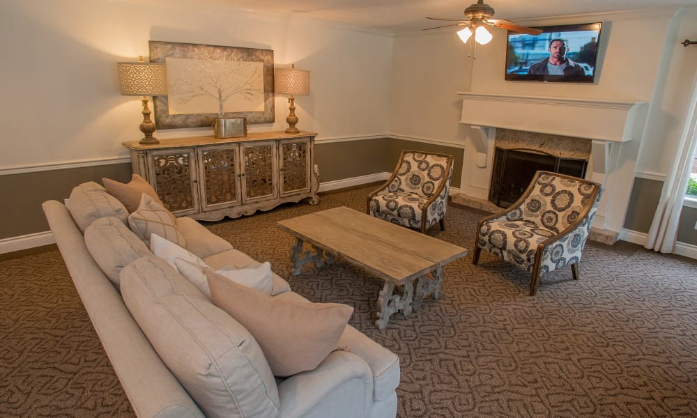 A large couch and seating area in the clubhouse at Cimarron Pointe Apartments in Oklahoma City, OK