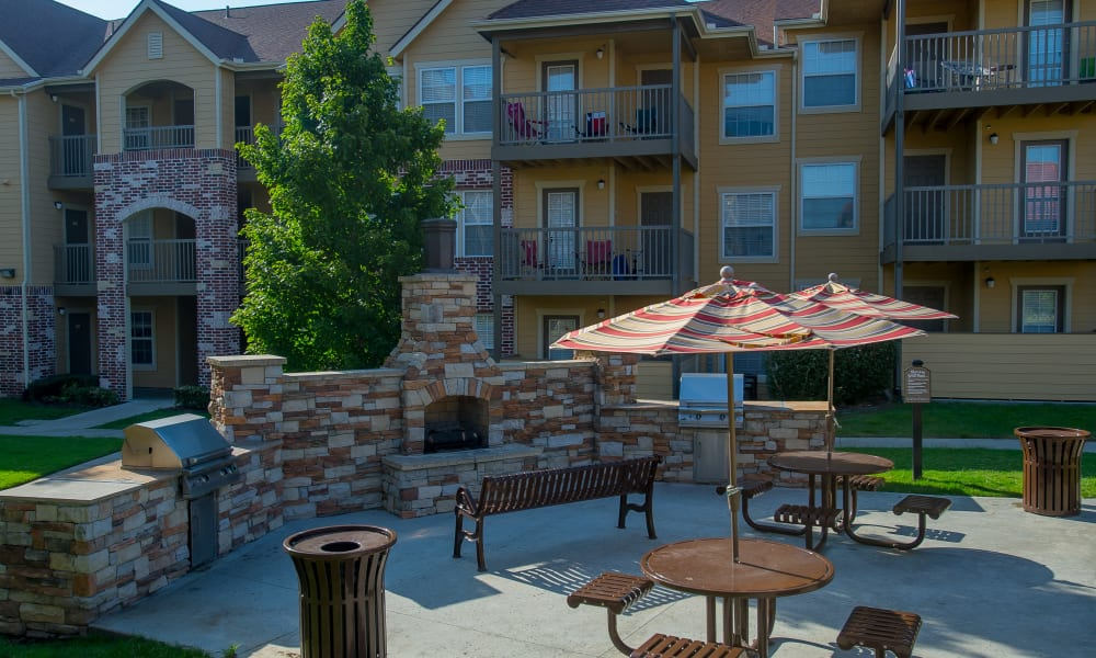 Picnic area with grill access at Coffee Creek Apartments in Owasso, Oklahoma