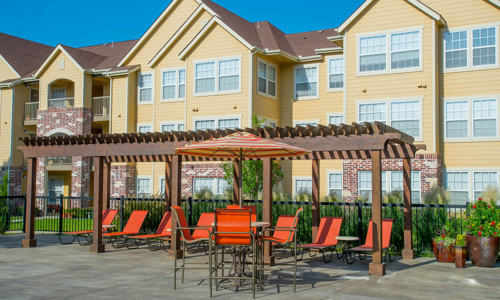 Seating by the pool at Coffee Creek Apartments in Owasso, Oklahoma