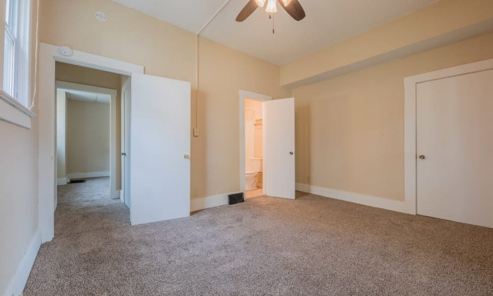 Master bedroom with ceiling fan at Pleasant Street Apartments in Des Moines, Iowa