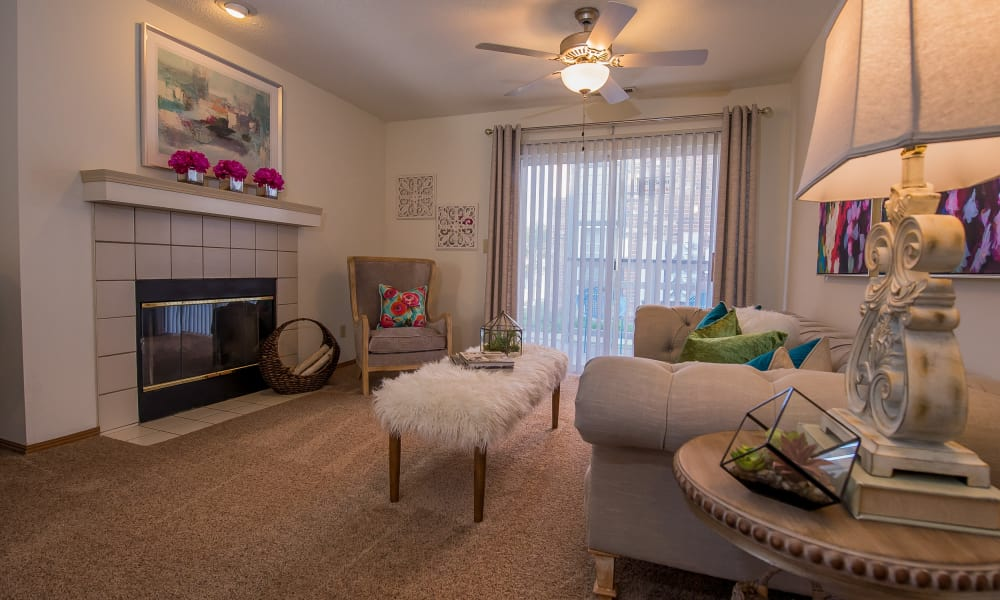 Living room with a fireplace at Huntington Park Apartments  in Wichita, Kansas