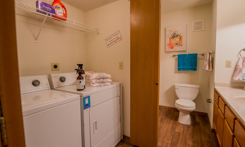 Bathroom with washer and dryer at Huntington Park Apartments  in Wichita, Kansas