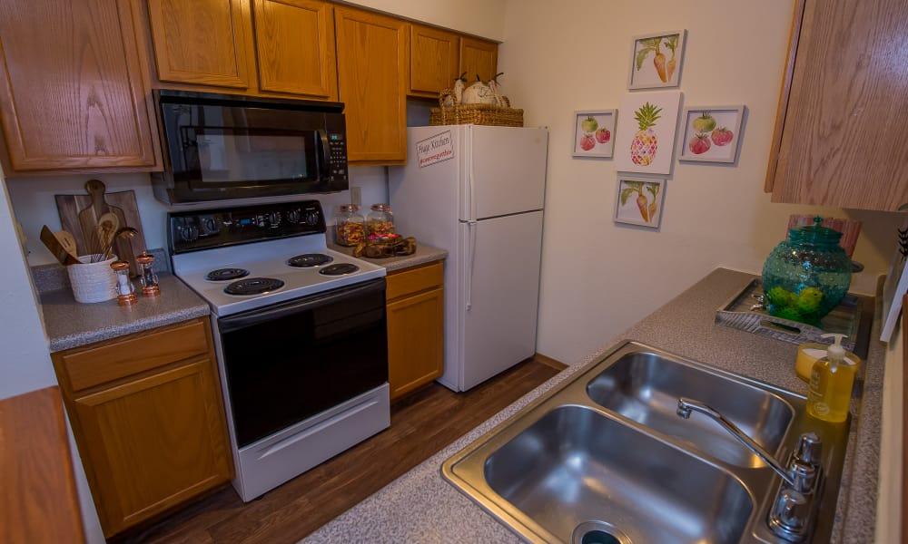 Kitchen at Huntington Park Apartments  in Wichita, Kansas
