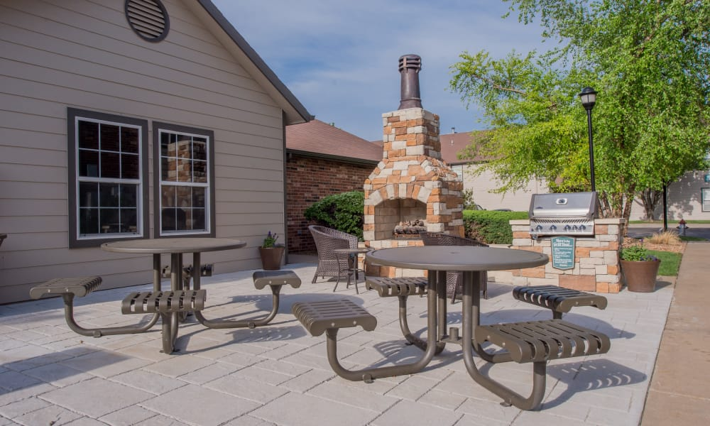 Outdoor patio with a grill at Huntington Park Apartments  in Wichita, Kansas