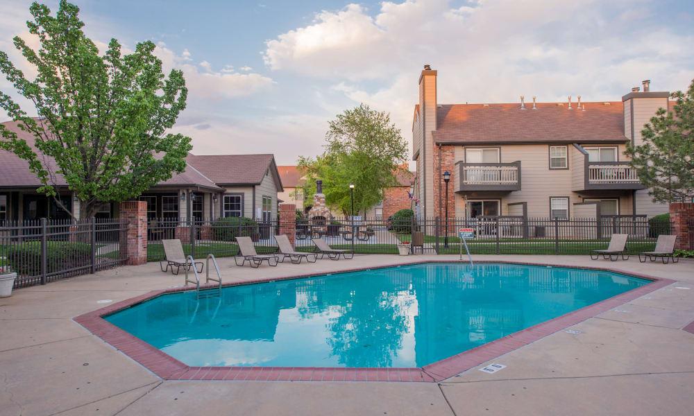 Luxurious swimming pool at Huntington Park Apartments  in Wichita, Kansas
