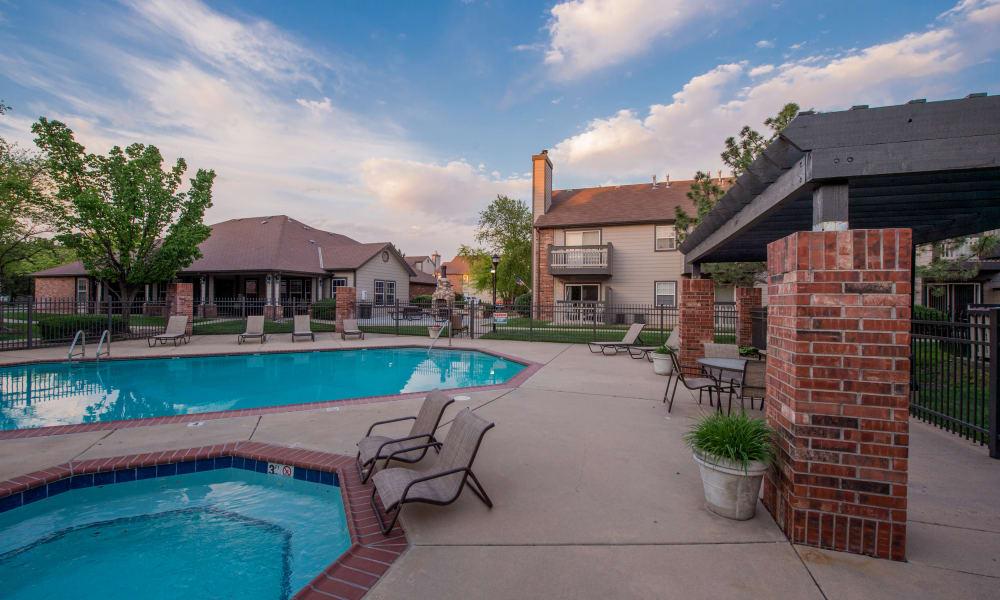 Poolside seating at Huntington Park Apartments  in Wichita, Kansas