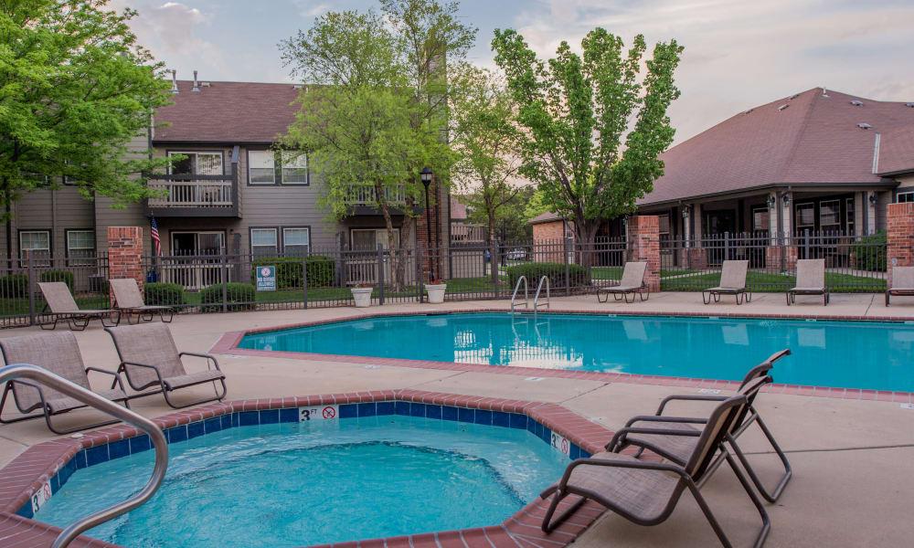 Hot tub and swimming pool at Huntington Park Apartments  in Wichita, Kansas