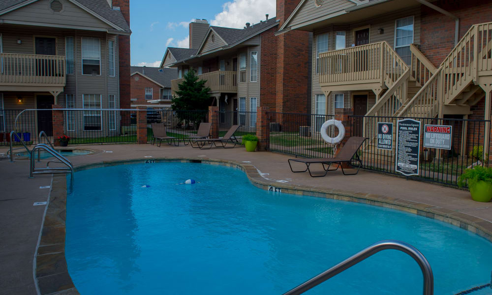 Resort-style swimming pool at Persimmon Square Apartments in Oklahoma City, Oklahoma