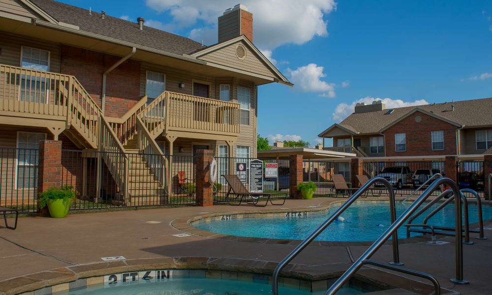Pool and hot tub at Persimmon Square Apartments in Oklahoma City, Oklahoma