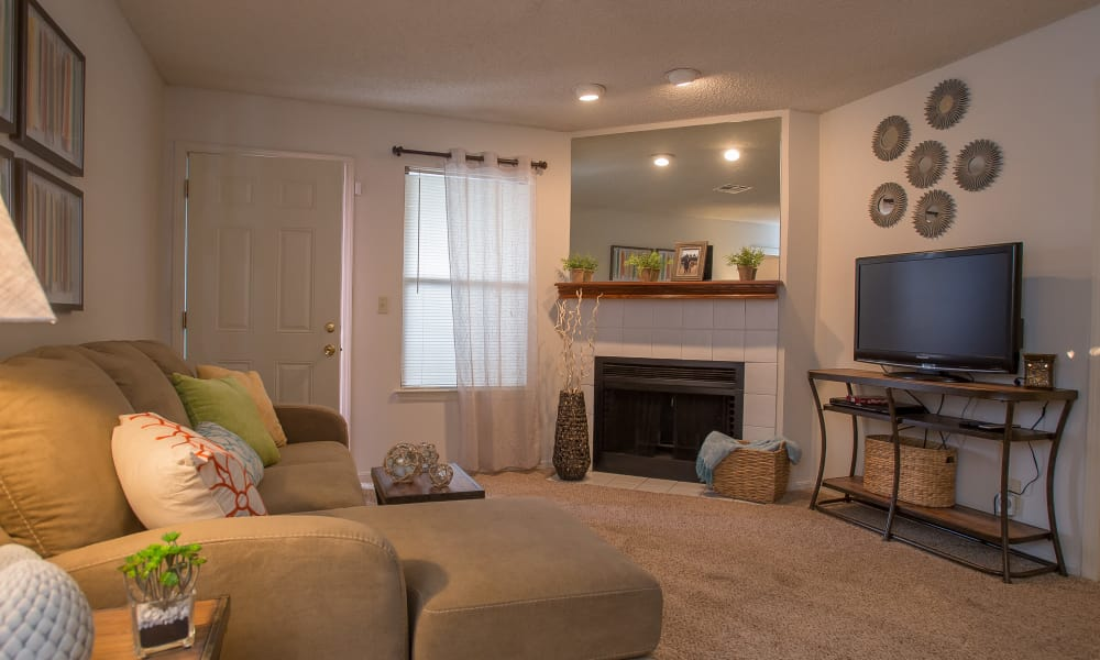 Living area with a fireplace at Polo Run Apartments in Tulsa, Oklahoma