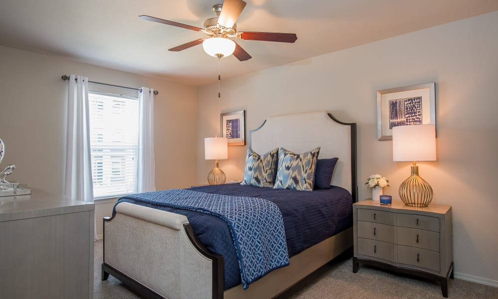 Bedroom with a ceiling fan at Scissortail Crossing Apartments in Broken Arrow, Oklahoma
