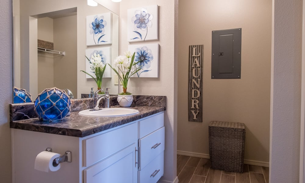 Bright bathroom at Scissortail Crossing Apartments in Broken Arrow, Oklahoma