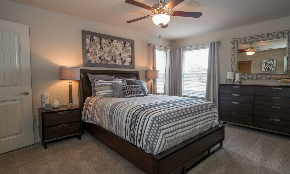 A well decorated bedroom at Scissortail Crossing Apartments in Broken Arrow, Oklahoma
