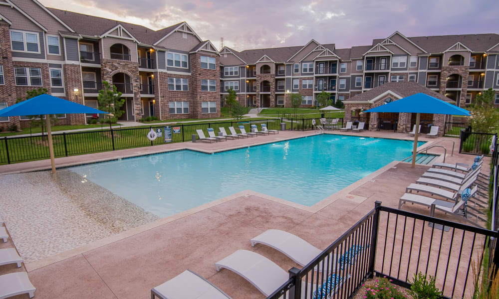 Poolside seating at Scissortail Crossing Apartments in Broken Arrow, Oklahoma