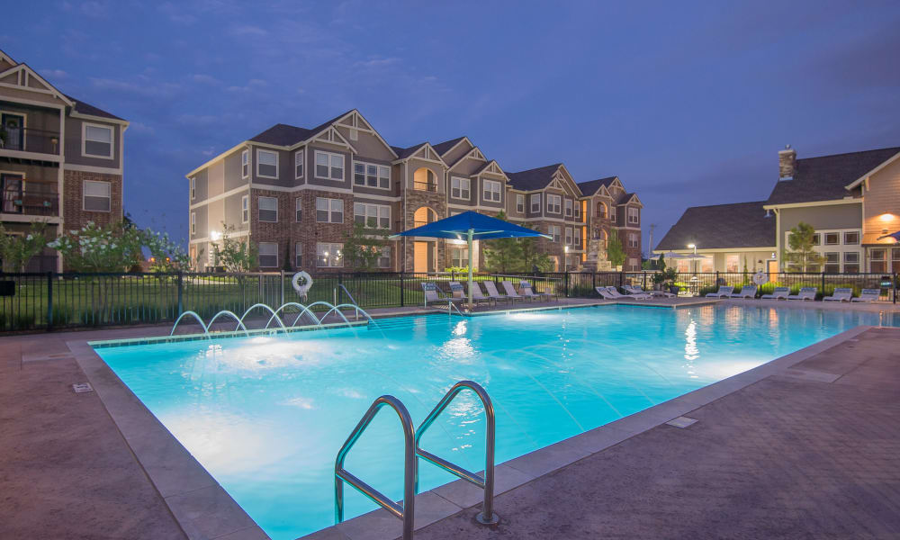 Pool with a water feature at Scissortail Crossing Apartments in Broken Arrow, Oklahoma