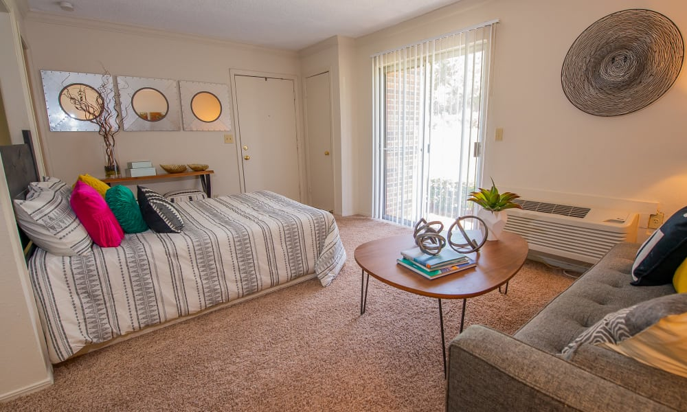 Well-lit bedroom at Summerfield Place Apartments in Oklahoma City, Oklahoma