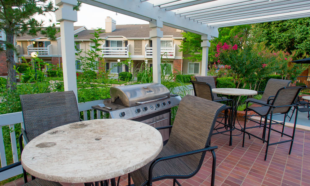 Outdoor patio with a grill at The Courtyards in Tulsa, Oklahoma