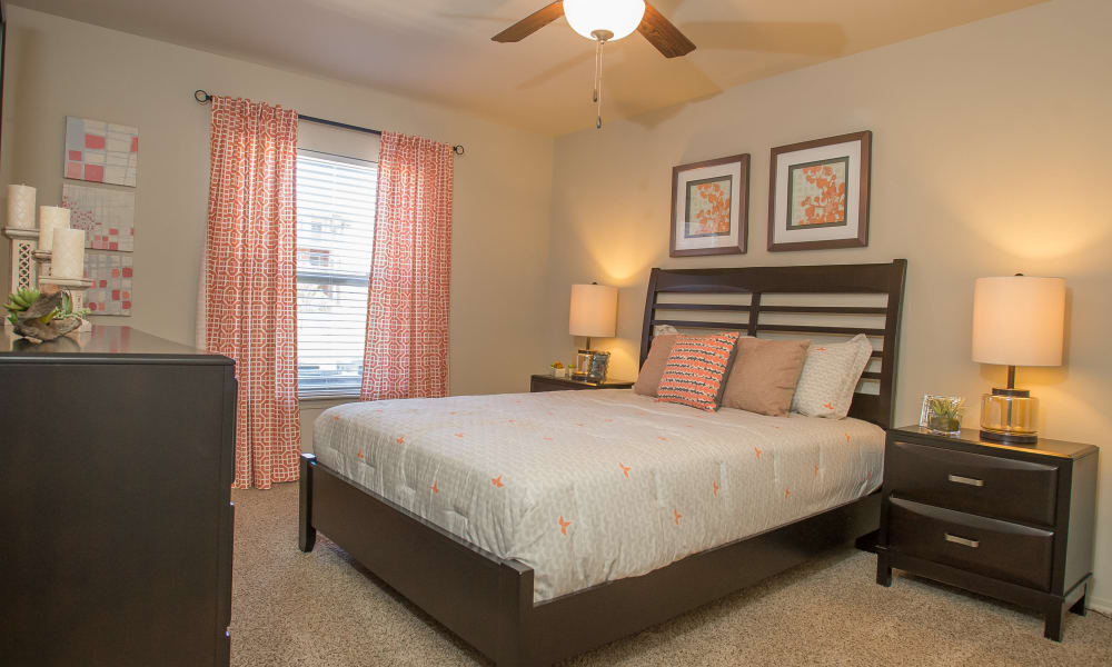 Bedroom with a ceiling fan at The Reserve at Elm in Jenks, Oklahoma