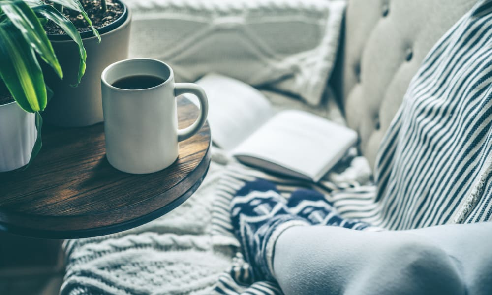 Cup of coffee and book at Stewartown Homes in Gaithersburg, Maryland