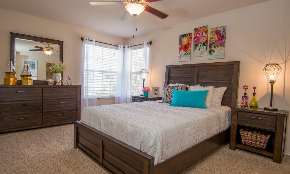 Bedroom with a ceiling fan at Villas at Aspen Park in Broken Arrow, Oklahoma