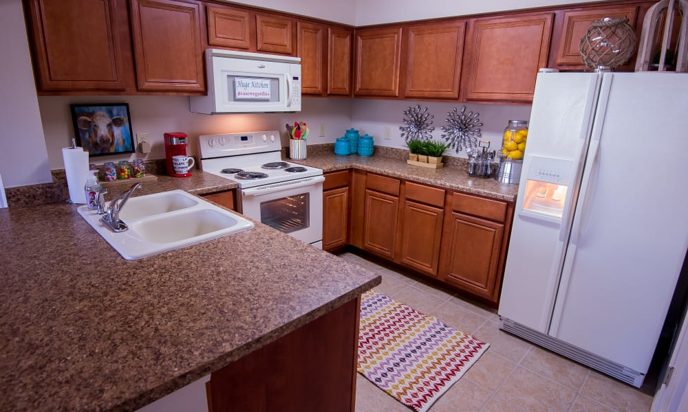 A large apartment kitchen at Villas at Aspen Park in Broken Arrow, Oklahoma