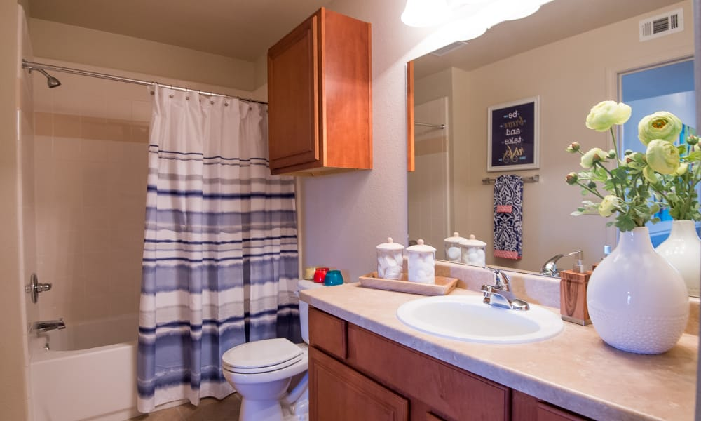 An apartment bathroom at Villas at Aspen Park in Broken Arrow, Oklahoma