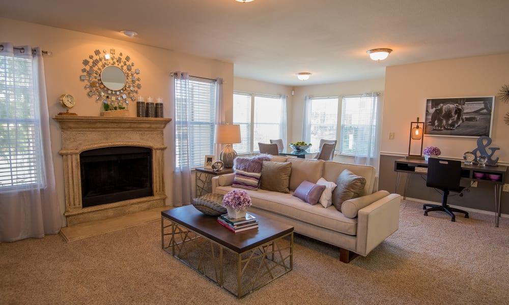 Living room with a fireplace at Villas at Aspen Park in Broken Arrow, Oklahoma