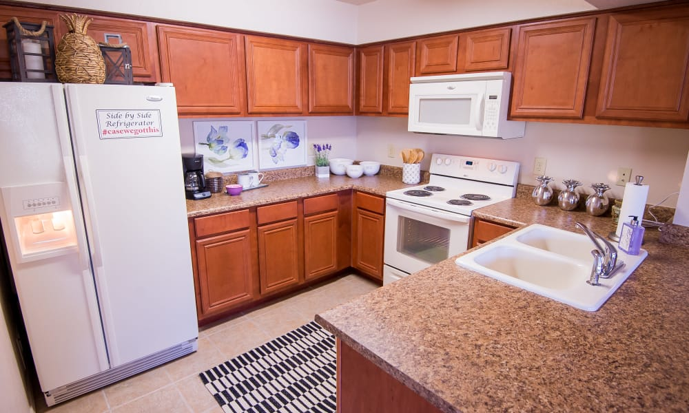 A large apartment kitchen at Villas at Aspen Park in Broken Arrow, Oklahoma