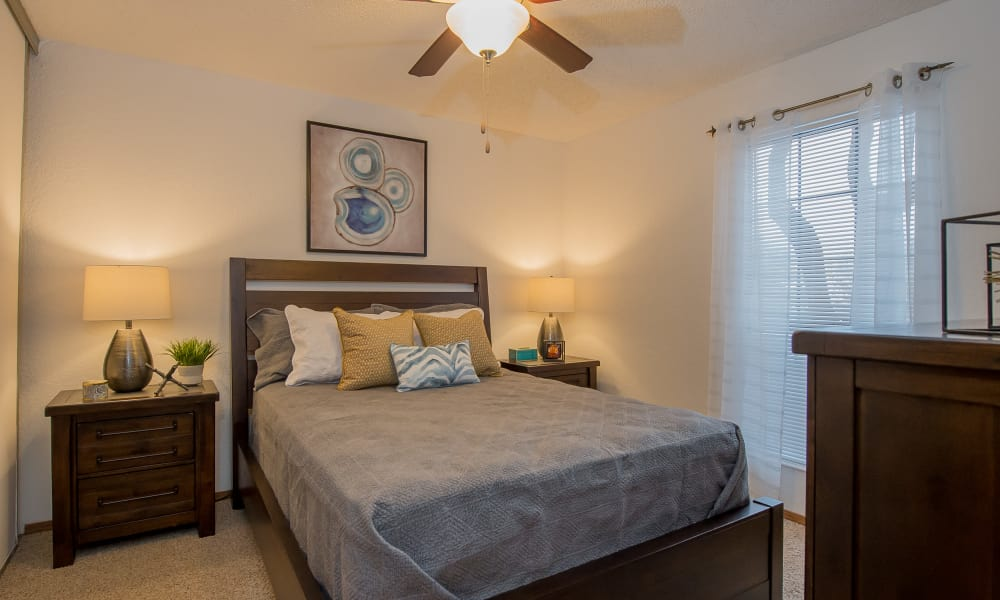 Well-lit bedroom at Warrington Apartments in Oklahoma City, Oklahoma