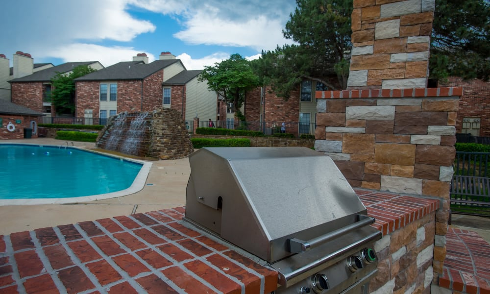 Grill area with a view of the pool at Warrington Apartments in Oklahoma City, Oklahoma