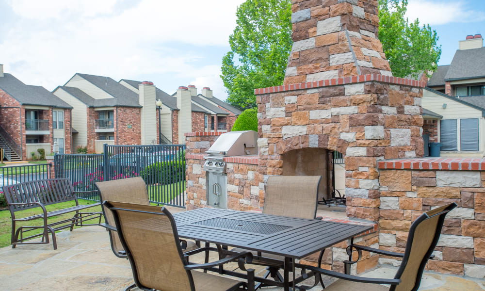 Outdoor patio with grill access at Warrington Apartments in Oklahoma City, Oklahoma