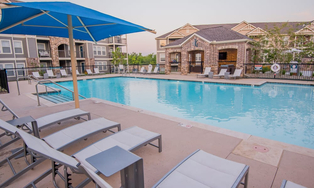 Covered poolside seating at Cottages at Crestview in Wichita, Kansas