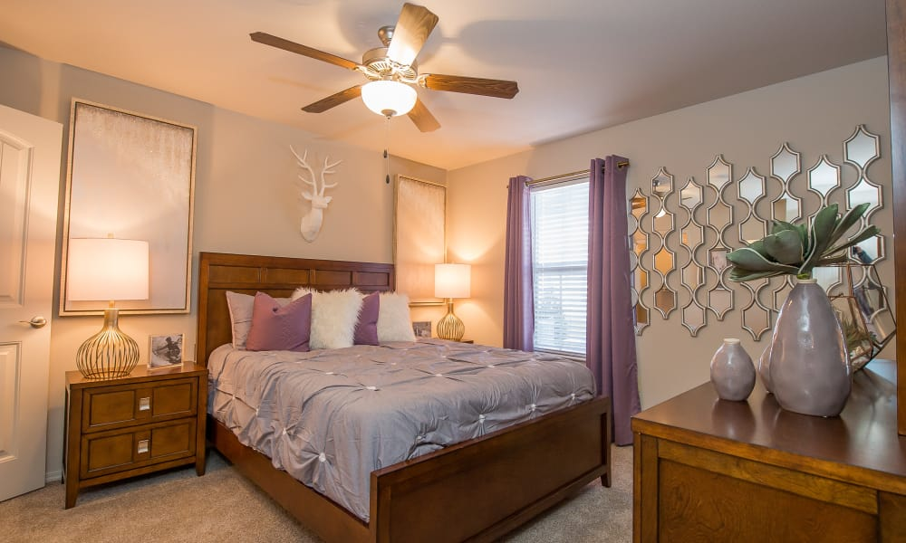 Well lit master bedroom at Cottages at Crestview in Wichita, Kansas