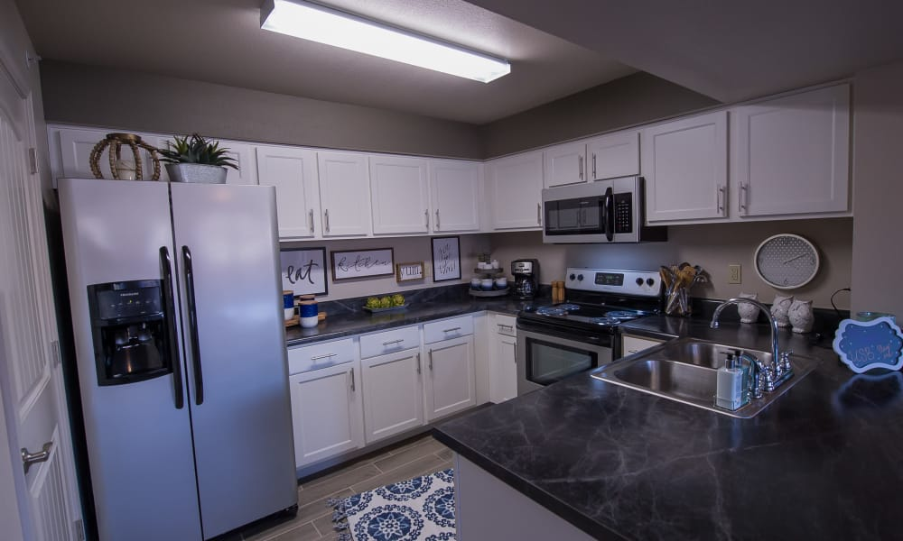 Kitchen with stainless steel appliances at Cottages at Crestview in Wichita, Kansas