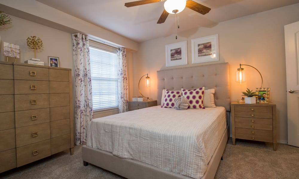 Well decorated bedroom at Cottages at Crestview in Wichita, Kansas