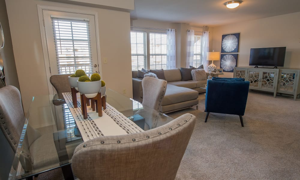 Dining room table with a view of the living room at Cottages at Crestview in Wichita, Kansas