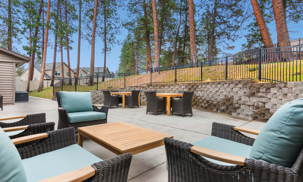 Outdoor patio with seating at Mill View Memory Care in Bend, Oregon