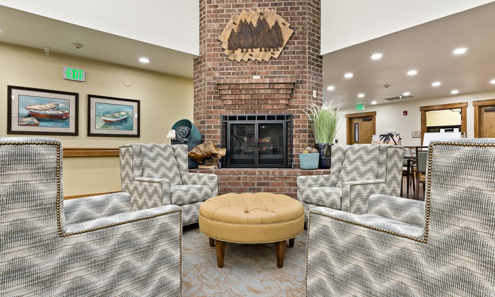 Common area with a fireplace at Mill View Memory Care in Bend, Oregon