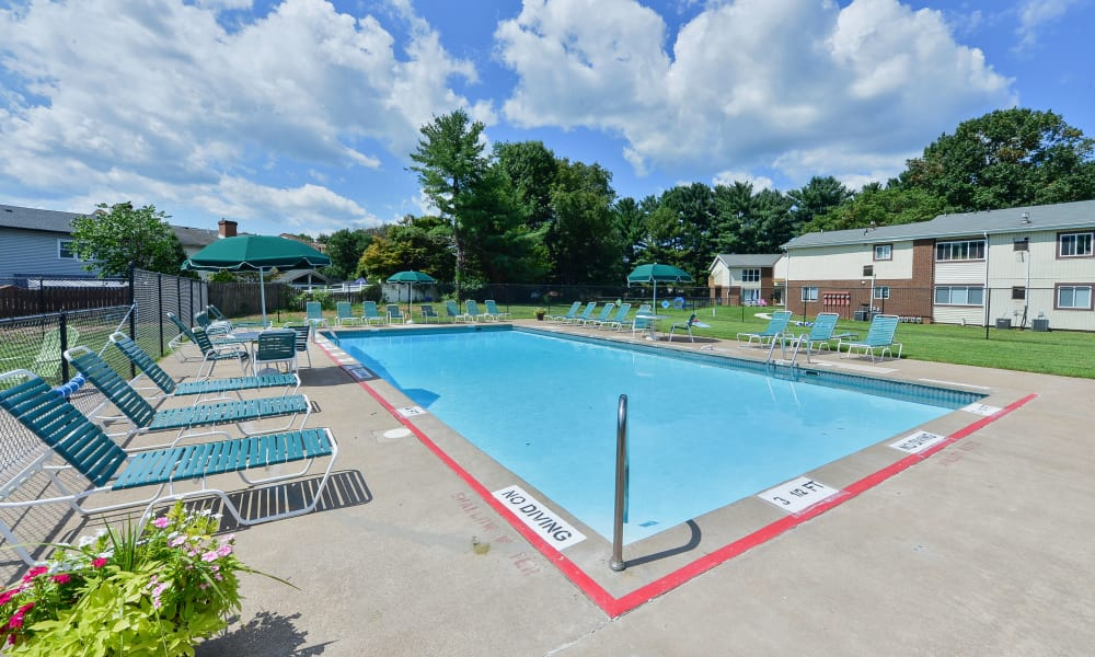 Expansive pool deck Oxford Manor Apartments & Townhomes in Mechanicsburg, PA