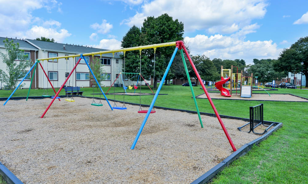 Swings and playground at Oxford Manor Apartments & Townhomes in Mechanicsburg, PA