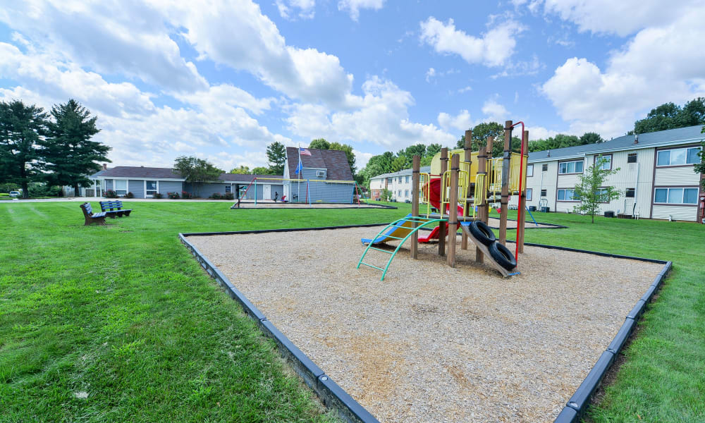 Playground and open grassy area at Oxford Manor Apartments & Townhomes in Mechanicsburg, PA