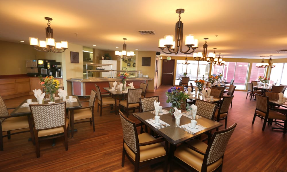 Dining hall with hardwood floors at Elk Meadows Assisted Living in Oakley, Utah
