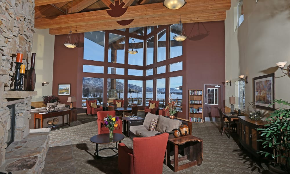 Lobby with large windows at Elk Meadows Assisted Living in Oakley, Utah