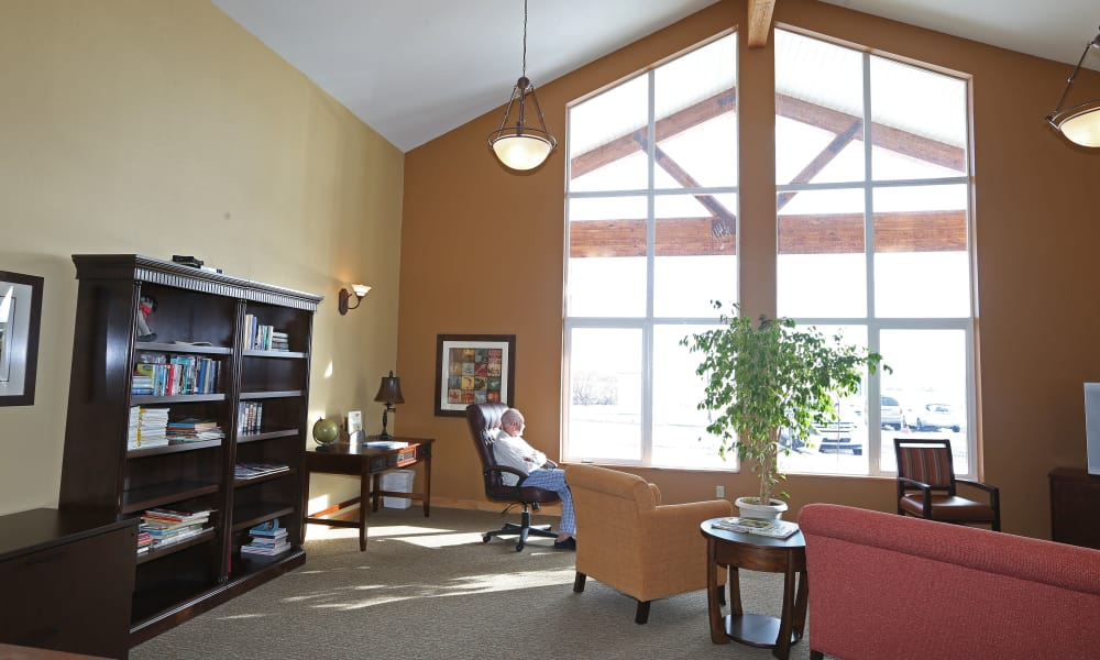 Resident sitting by a window at Elk Meadows Assisted Living in Oakley, Utah