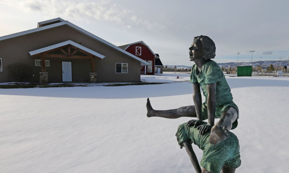 Statue of children playing at Elk Meadows Assisted Living in Oakley, Utah