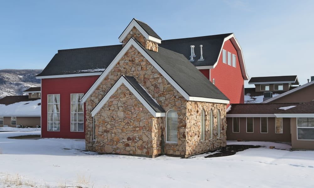 Outdoor view of snowy Elk Meadows Assisted Living in Oakley, Utah