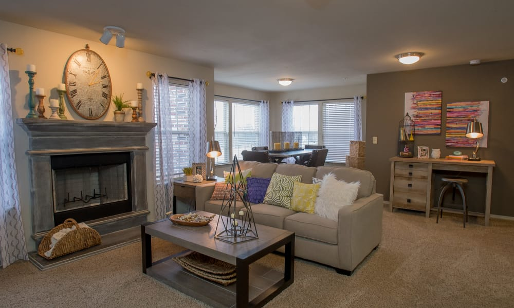 Well decorated living room with a fireplace at Portofino Apartments in Wichita, Kansas