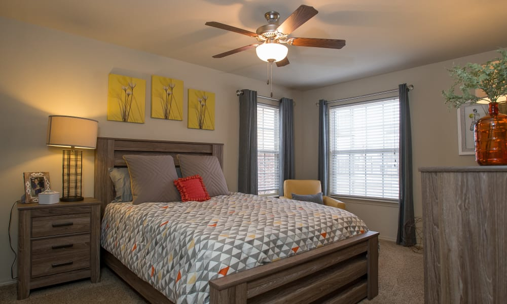 Primary bedroom with a ceiling fan at Portofino Apartments in Wichita, Kansas