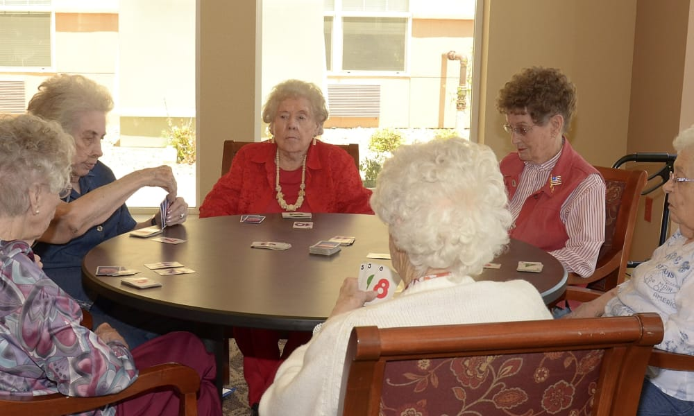 Residents playing cards at Wheatfields Senior Living Community in Clovis, New Mexico